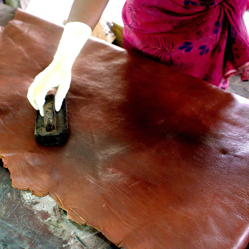pressing and flattening of brown leather