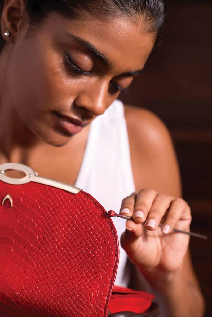 needlepoint finishing colouring of red leather bag