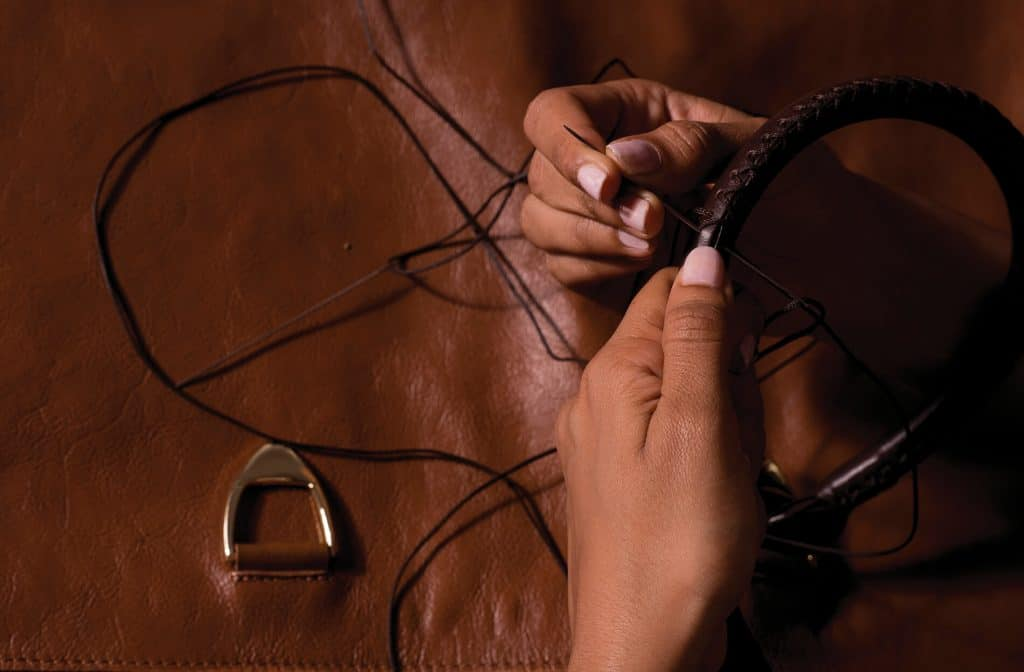 hand stitching crafting of brown leather belt
