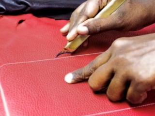 hand cutting of red leather