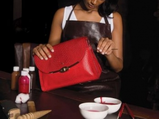 finishing red leather womens bag by hand