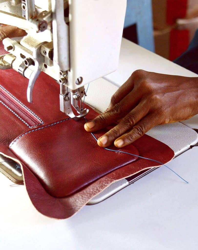 sewing pockets on dark leather bags