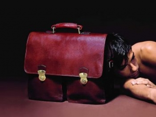 man with red leather briefcase and buckles