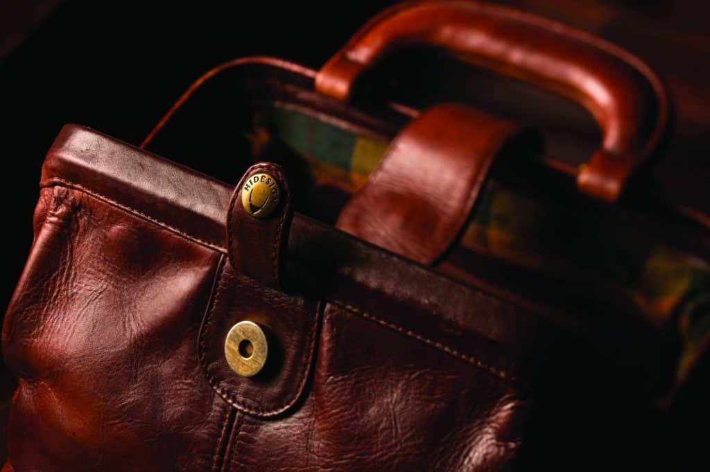 brown leather hidesign bag buckle and handle