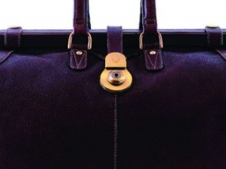 dark leather holdall travel bag with handle