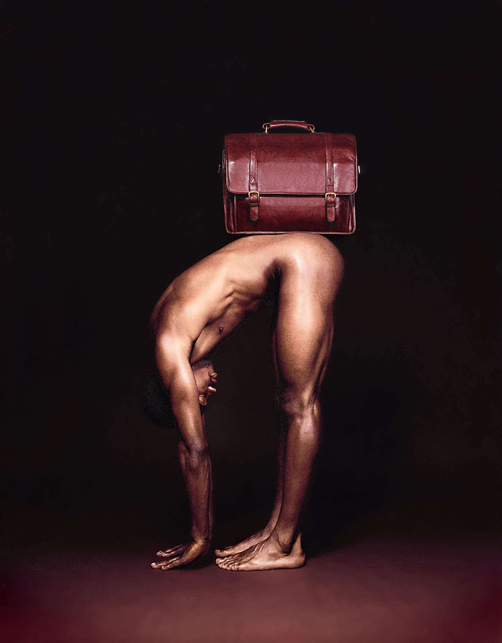 naked male model with brown leather briefcase