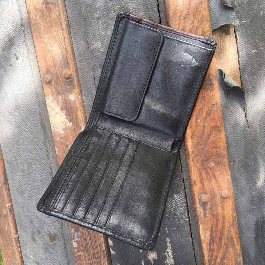 interior view of men's vegetable tanned black and brown leather wallet