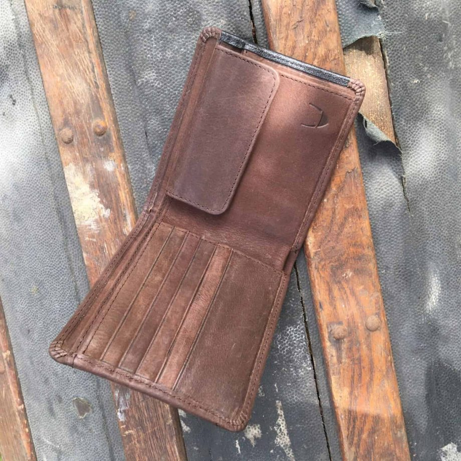 interior view of men's vegetable tanned brown and black leather wallet
