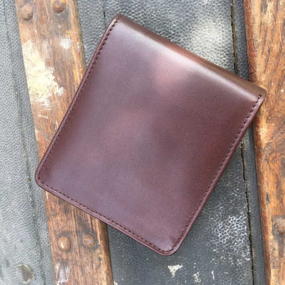 back view of brown leather men's wallet with contrast design detail