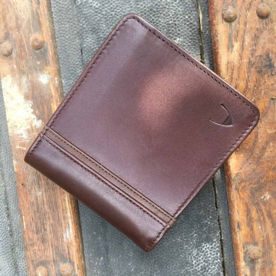 front view of brown leather men's wallet with contrast design detail