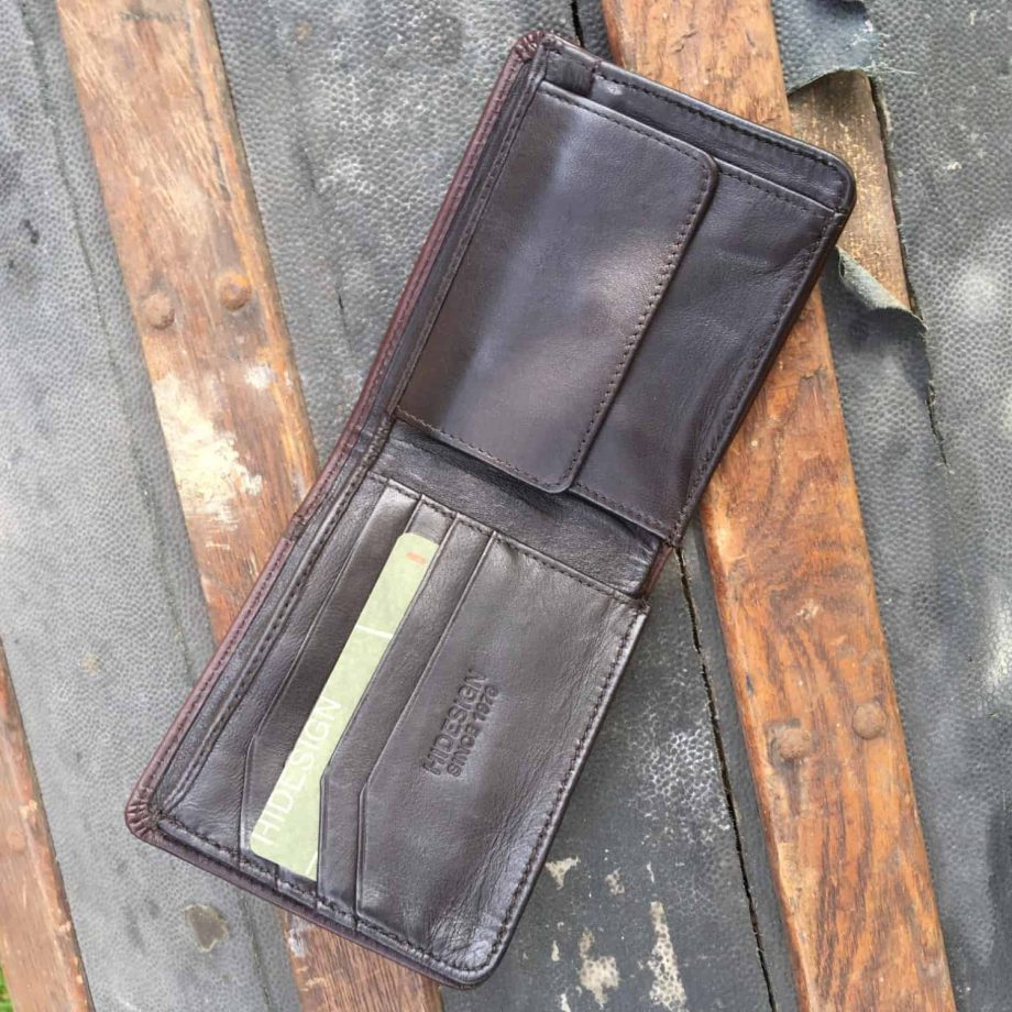 interior view of brown leather men's wallet with contrast design detail