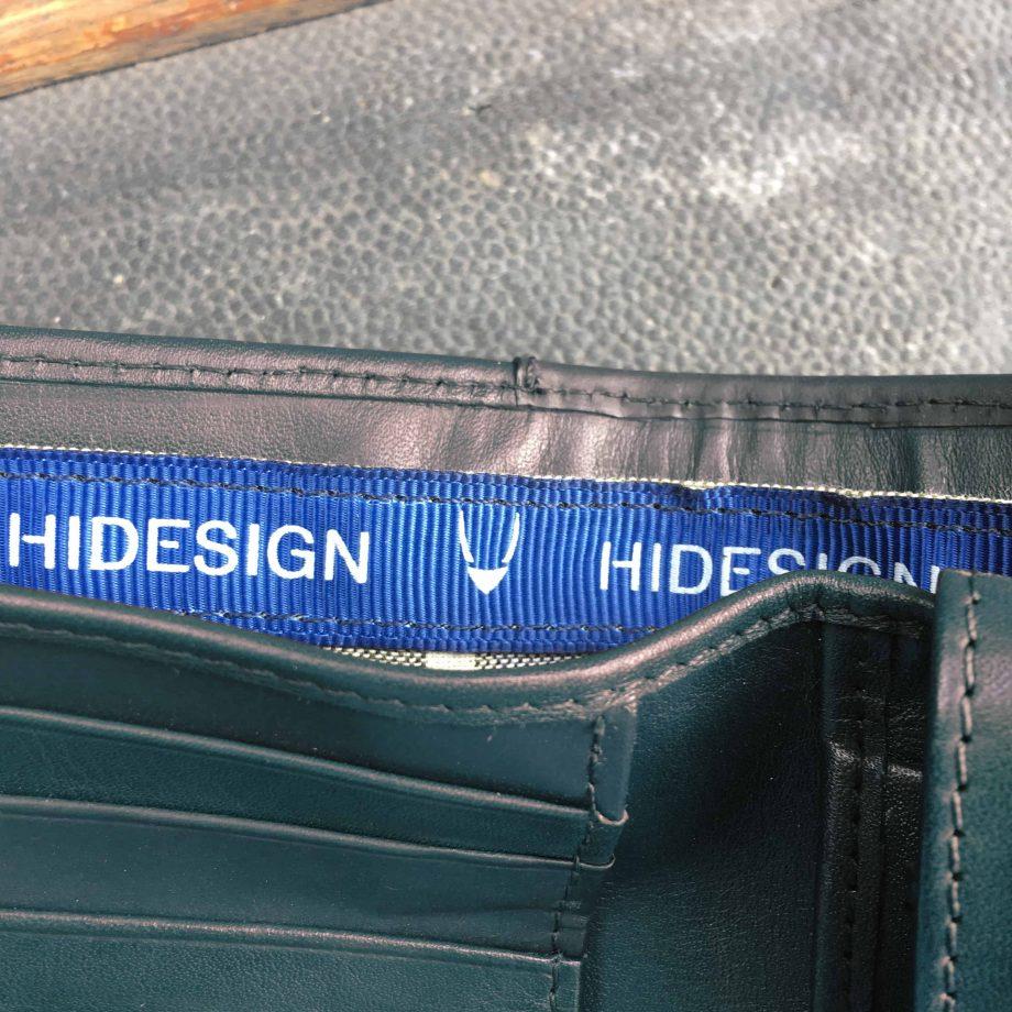 interior blue branded strip in black leather hip wallet