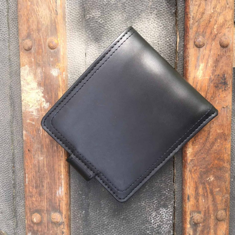 back view of brown leather wallet with press stud closure