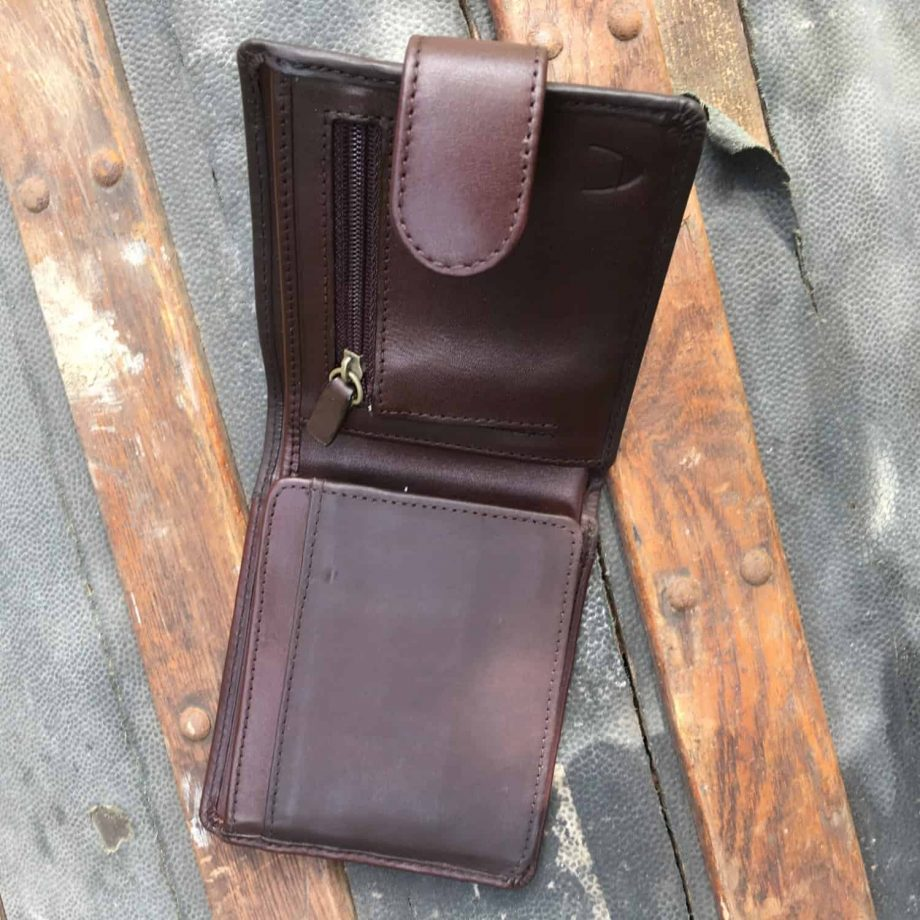 inside view of brown leather wallet with press stud closure