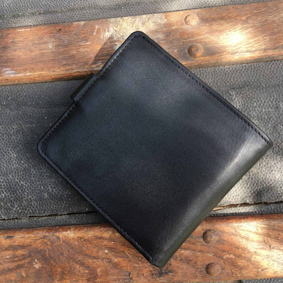 Reverse view of black vegetable tanned leather hip wallet