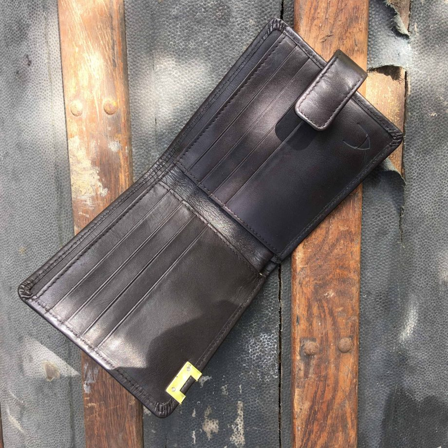 inside view of brown vegetable tanned leather hip wallet