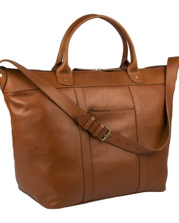 side view of small roberto holdall made from soweto leather in tan